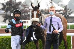 Jockey David Nolin Alongside Winning Horse Gallipoli And Groom