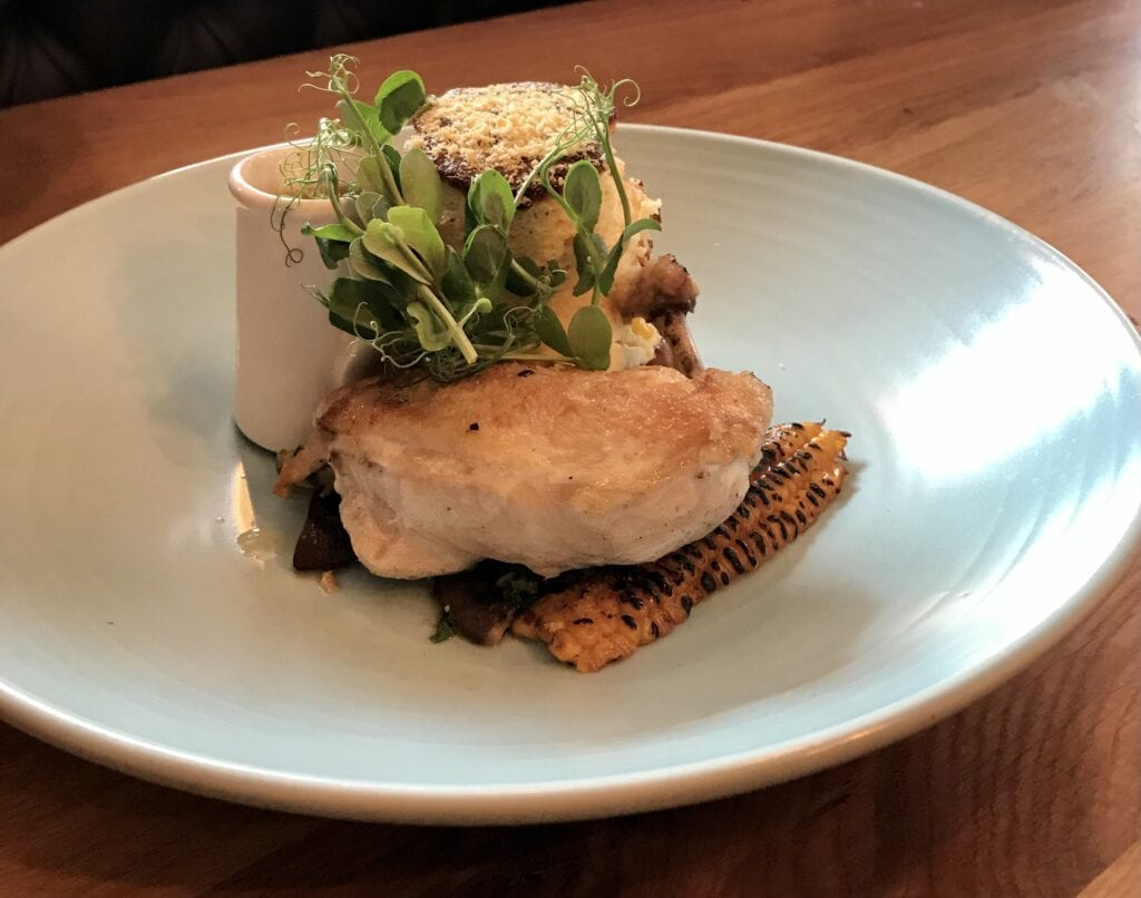 the yard roast chicken breast confit potato pecorino sweetcorn souffle wild mushroom sauce